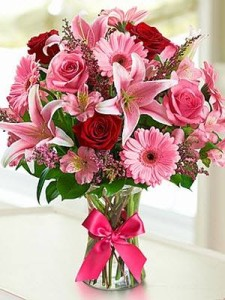Roses and pink and red with pink gerbera daisies Vased